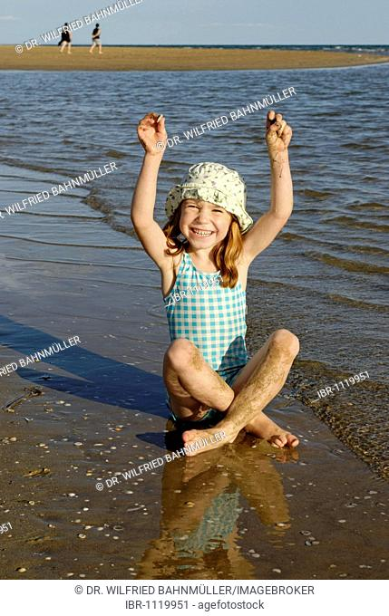 Girl with sunhat on the beach, waterfront, seaside of the Adria, Bibione, Venetia, Venice, Italy, Europe