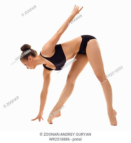 Beautiful ballerina warming up, isolated on white