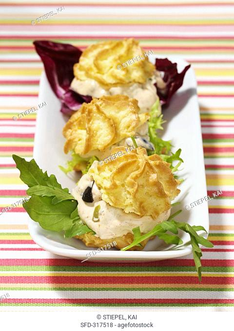 Savoury profiteroles filled with soft cheese and olives