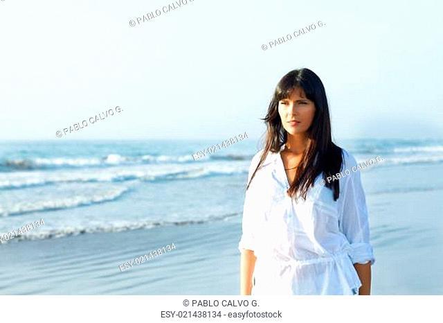 girl walking along the seashore
