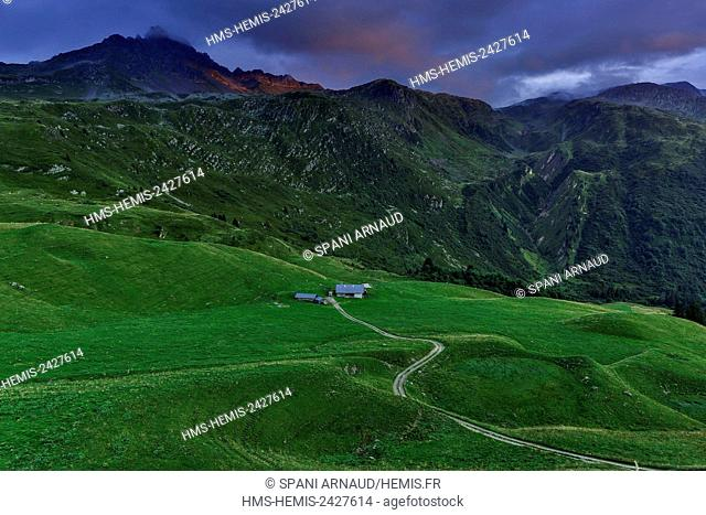 France, Savoie, Beaufortain, Hauteluce, view peaks and alpine meadows at sunset, under a cloudy sky