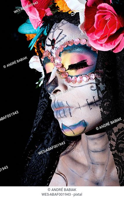 Woman dressed as La Calavera Catrina, Traditional Mexican female skeleton figure symbolizing death