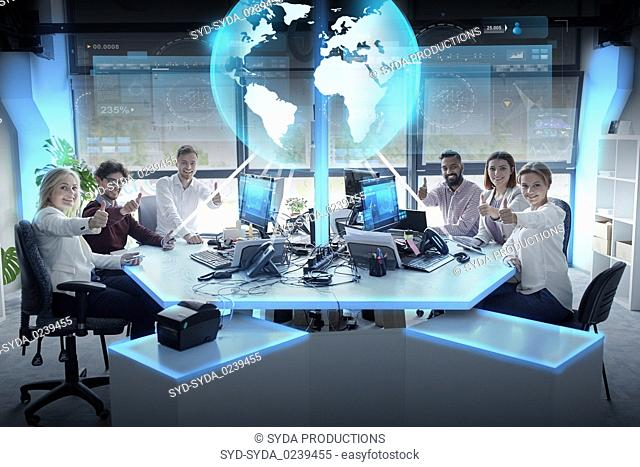 happy business team with earth hologram at office
