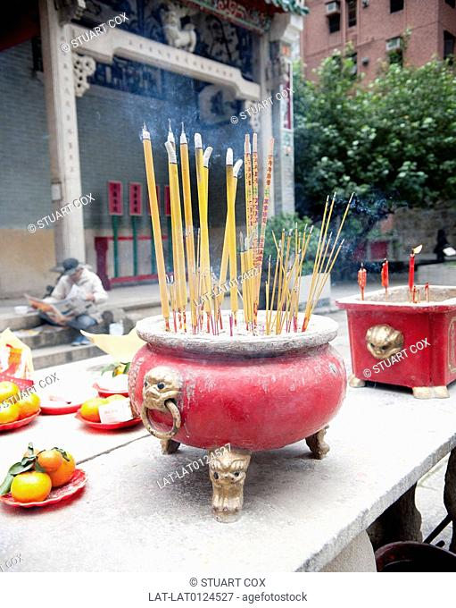 Tin Hau Temple is a traditional Buddhist temple,with large incense burners or urns containing joss sticks in the courtyard. e