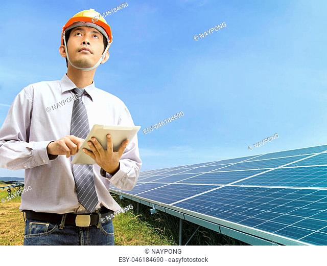 Engineers using digital tablet working and checking at industry solar power
