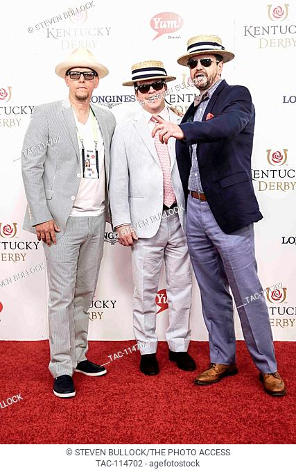 Bob Wahlberg, Paul Wahlberg and Jim Wahlberg styling as a family in straw hats and jackets