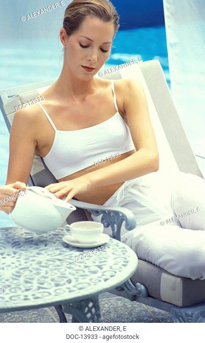 woman drinks tea and slacked