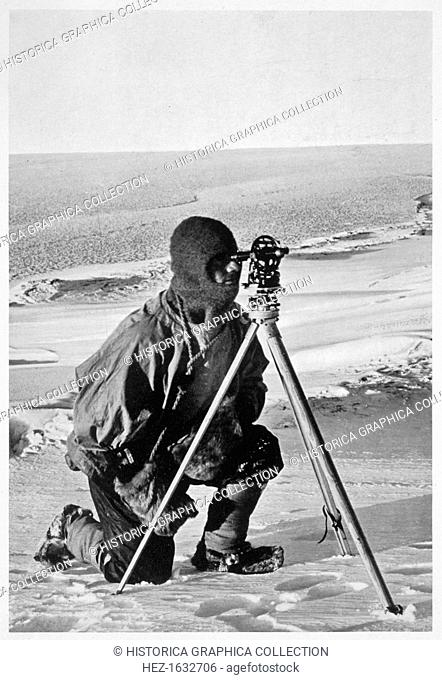 Lieutenant Evans surveying in the Antarctic, 1911-1912. Evans using the 4 inch theodolite used to locate the South Pole on Captain Scott's Antarctic expedition...