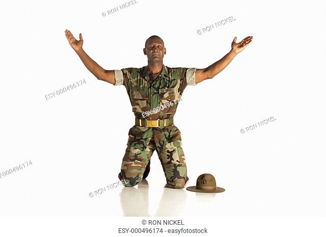 fort lauderdale, florida, united states of america, a military man with arms raised and eyes closed