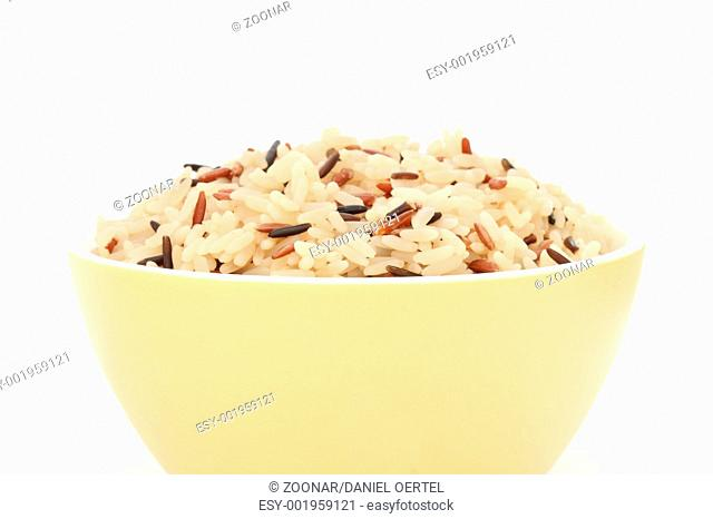 Yellow bowl with cooked rice of various types