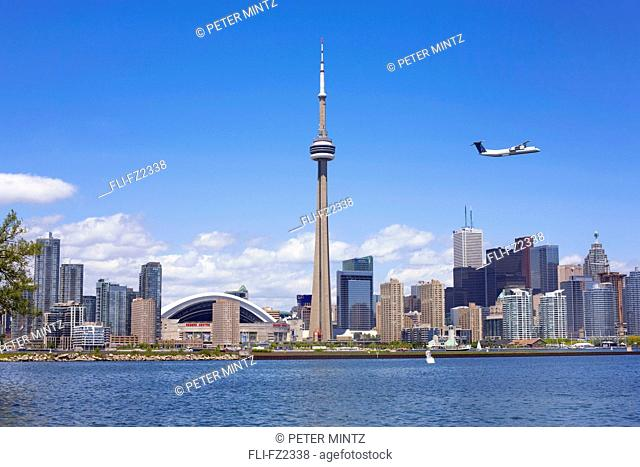 City skyline from Hanlan's Point, with jet taking off from Toronto Island Airport, Toronto, Ontario
