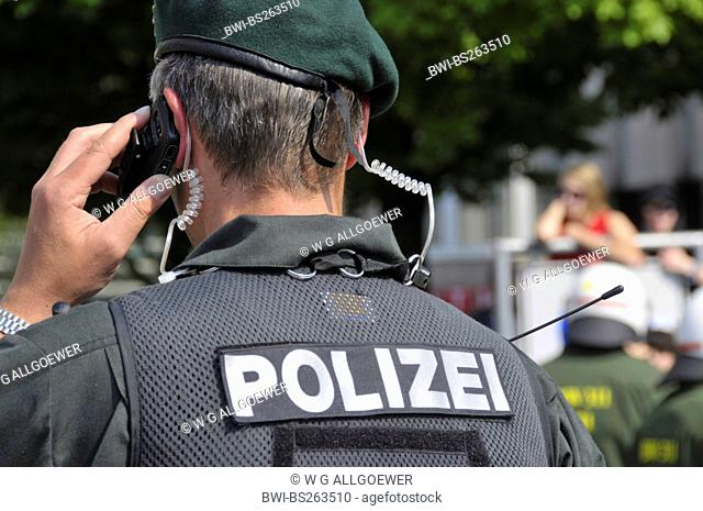 policeman of arrest unit with cell phone, Germany, Baden-Wuerttemberg