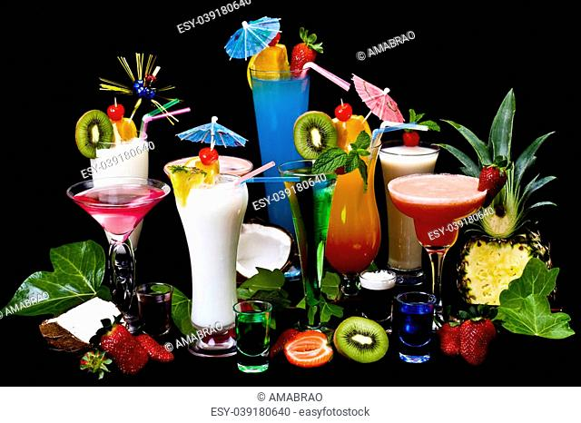 Decorated cocktails (Blue Lagoon, Cosmopolitan, Pina Colada, Strawberry and Margarita) over Black background