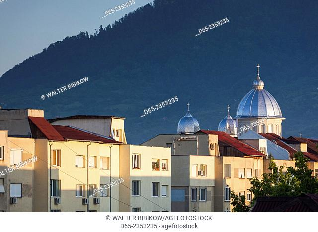 Romania, Maramures Region, Baia Mare, buildings along Republicii Boulevard and Nasterea Domnului Orthodox Church, dawn