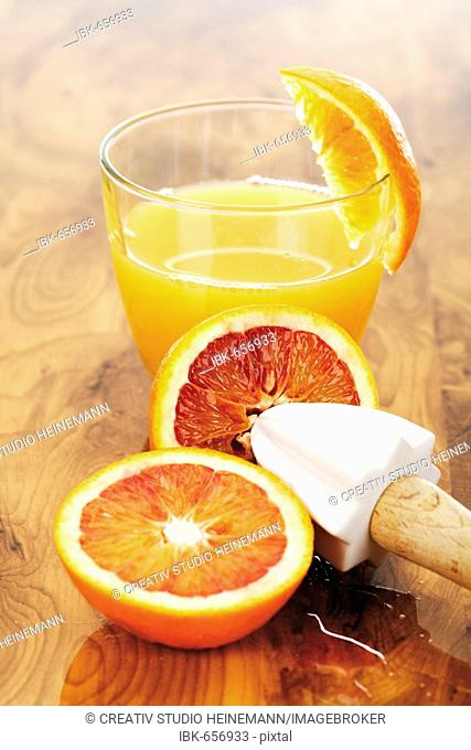 Blood oranges and a glass of orange juice