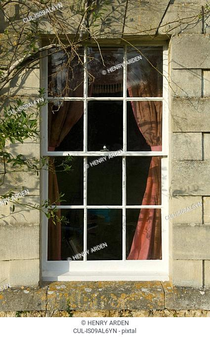 Downstairs window of traditional stone house