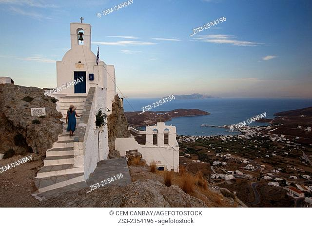 Woman climbing up the stairs of the Agios Constantinos church in Hora, Serifos, Cyclades Islands, Greek Islands, Greece, Europe