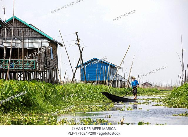 Traditional wooden houses on bamboo stilts in Inle Lake, Nyaungshwe, Shan State, Myanmar / Burma