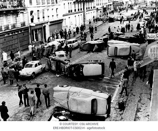 RIOTS-Auto Barricade on Guy Lussac Street in Paris during the riots of 1968
