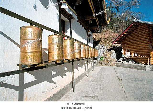 Prayer wheels outside the temple of Luguhu Island, Lugu Lake, NingLang County, Lijiang City, Yunnan Province of People's Republic of China