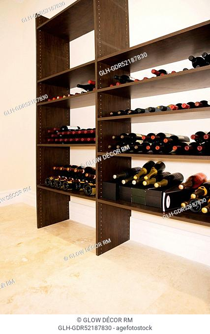 Alcoholic bottles on shelves