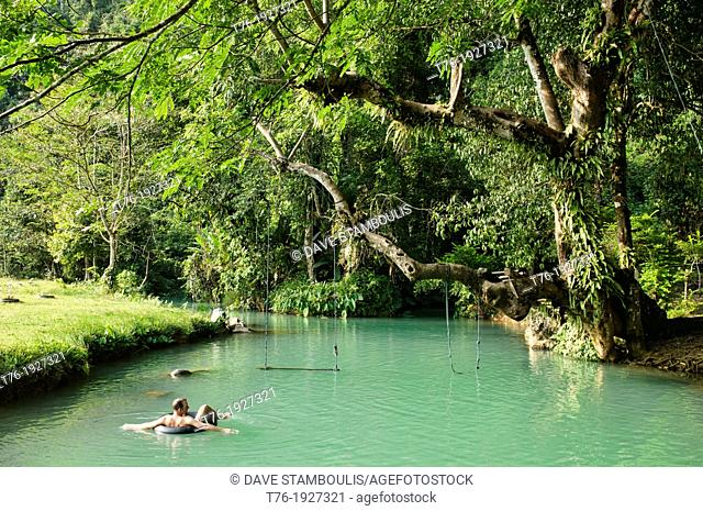 Enjoying the emerald water of the Blue Lagoon in Vang Vieng, Laos