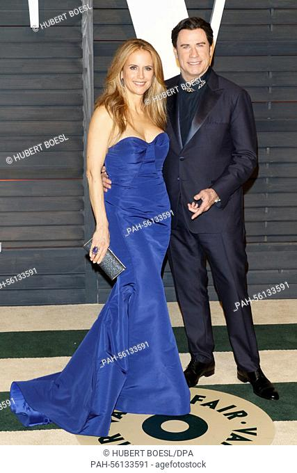 Actor John Travolta and his wife, Kelly Preston, attend the Vanity Fair Oscar Party at Wallis Annenberg Center for the Performing Arts in Beverly Hills
