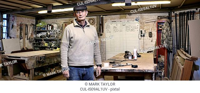 Portrait of a cabinet maker in his working environment