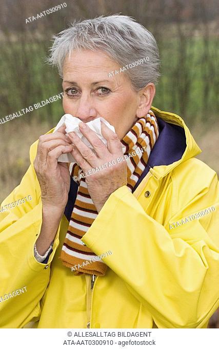 Elderly woman having a cold