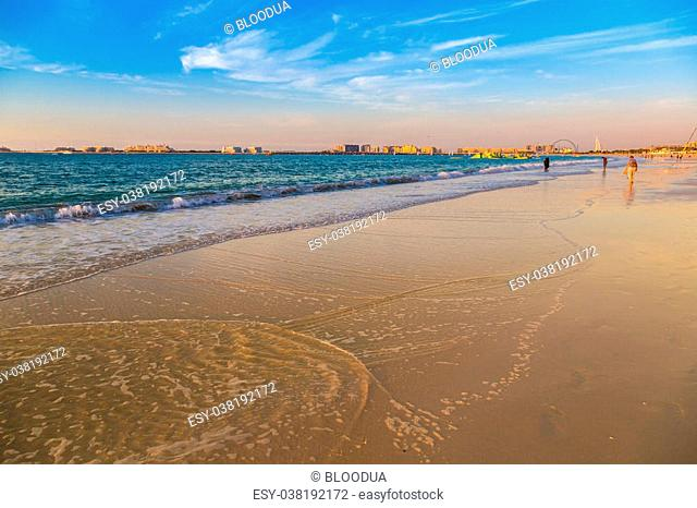 Dubai marina beach in the summer evening, sunset, UAE