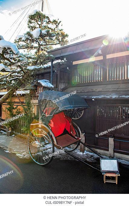 Traditional rickshaw parked outside traditional house, Takayama, Gifu, Japan