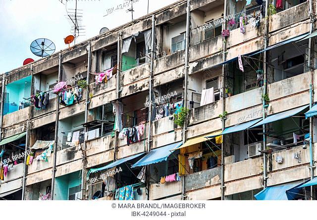 Derelict house facades with colourful laundry, Bangkok, Thailand