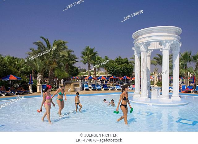Children playing in the pool, Three women walking through the water, WaterWorld Waterpark, Agia Napa, South Cyprus, Cyprus
