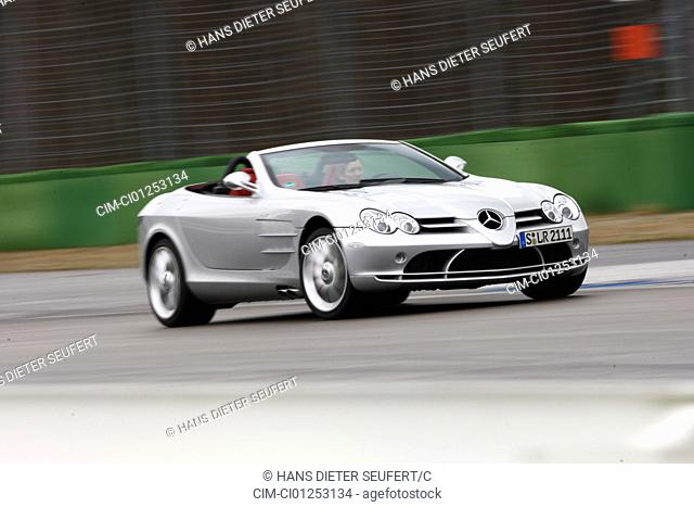 Mercedes SLR McLaren, model year 2008-, silver, driving, diagonal from the front, frontal view, test track, open top
