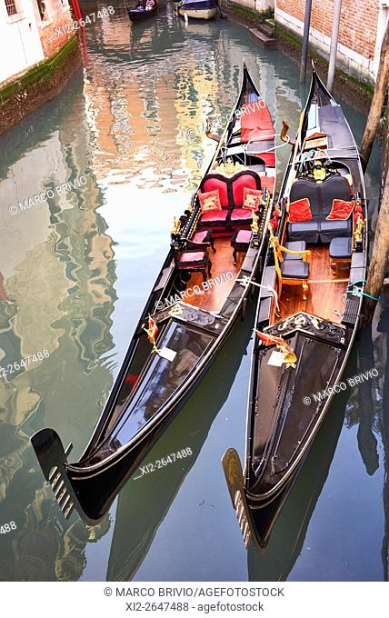 Two gondolas in the canals of the old Venice. Italy