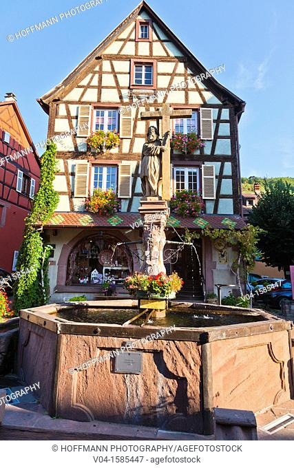 Picturesque timbered house with the Fontaine Constantin in the foreground, Kaysersberg, Alsace, France, Europe