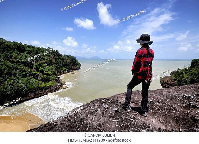 Malaysia, Borneo, Sarawak, Bako National Park, woman watching the South China sea from a lookout on the Telok Pandan Kecil trail