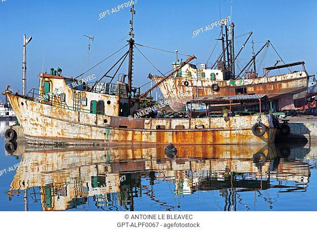 DOCKYARDS WITH OLD BOATS UNDERGOING REPAIRS IN THE BAY OF CIENFUGOS, FORMER PORT CITY POPULATED BY THE FRENCH IN THE 19TH CENTURY