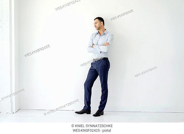 Businessman standing looking sideways
