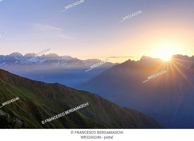 Sunrise at high altitude with Bernina mountain range in the background, Valmalenco, Valtellina, Lombardy, Italy, Europe