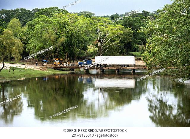 Truck over The Low Water bridge crosses the Macal River linking San Ignacio and Santa Elena, Cayo, west Belize, Central America