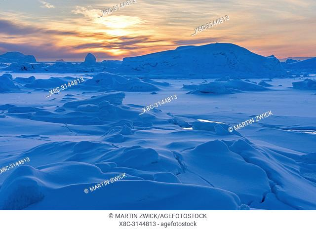 The shore of the frozen Disko Bay. Town Ilulissat at the shore of Disko Bay in West Greenland. The icefjord nearby is listed as UNESCO world heritage
