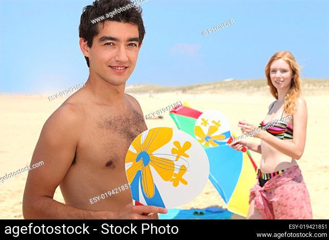 teenagers playing beach tennis