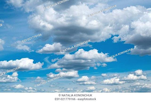 Cloudscape. The blue sky with white-grey clouds