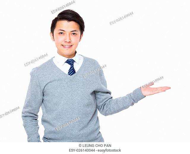 Young businessman with hand showing balnk sign