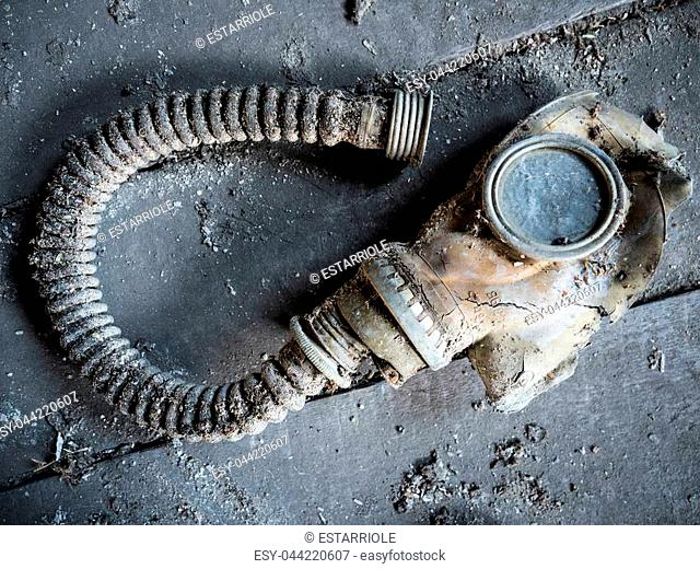 The old gas mask lies on the floor for many years