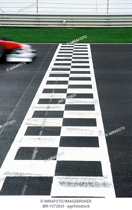 Formula 1 racecar crossing the finish-line at the Autodromo do Algarve racing circuit near Portimao, Portugal, Europe