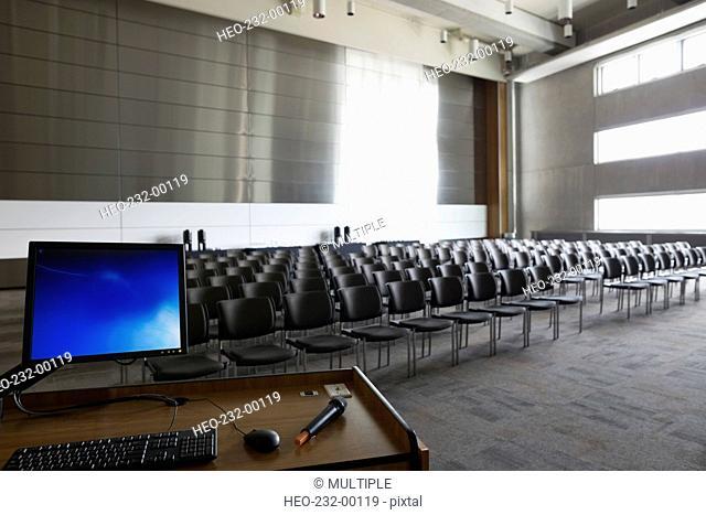 Computer at podium in empty auditorium