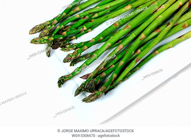 Wild asparagus on a white plate