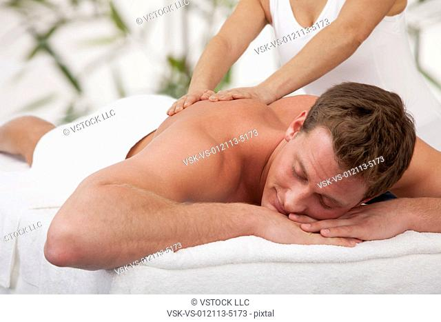 Man receiving massage, close-up